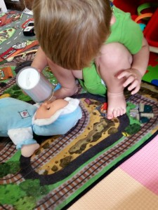 2.5 months after starting ABA therapy, he spontaneously pretended to feed the doll after observing me pretending to feed it while playing with both boys. Lack of pretend play is a characteristic of autism.